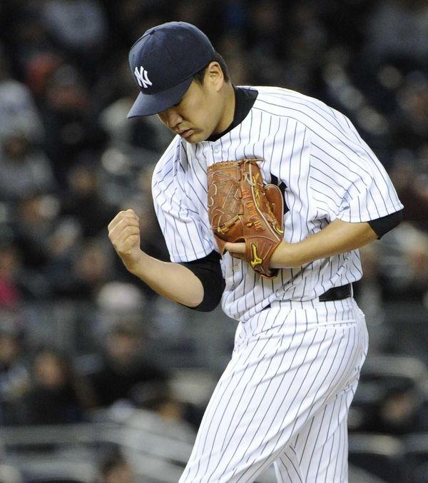 Yankees starting pitcher Masahiro Tanaka gestures on the