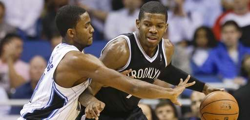Nets' Joe Johnson, right, looks for a way