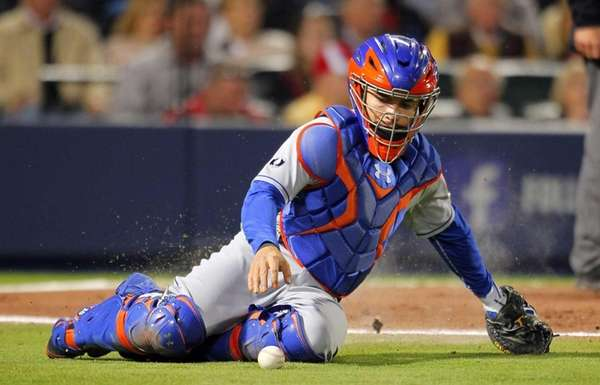 Mets catcher Travis d'Arnaud chases a wild pitch