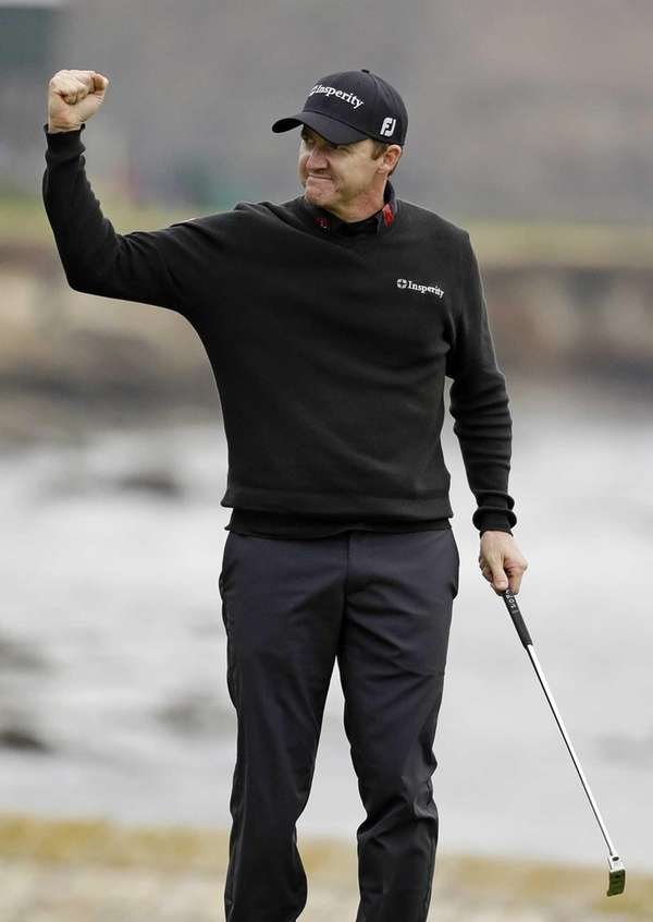 Jimmy Walker reacts on the 18th green of