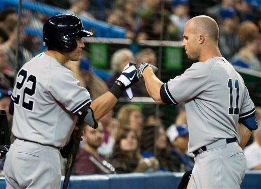 Yankees left fielder Brett Gardner, right, celebrates his