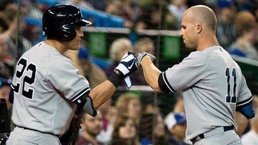 Yankees left fielder Brett Gardner, right, celebrates his