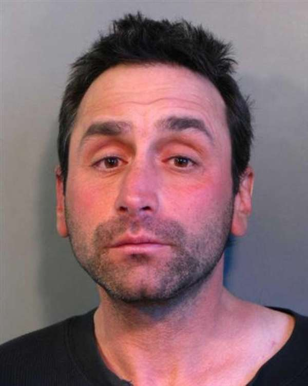 Frank Alfisi, 46, of Westbury, is charged with