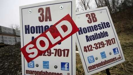 A sold sign is placed on a homesite