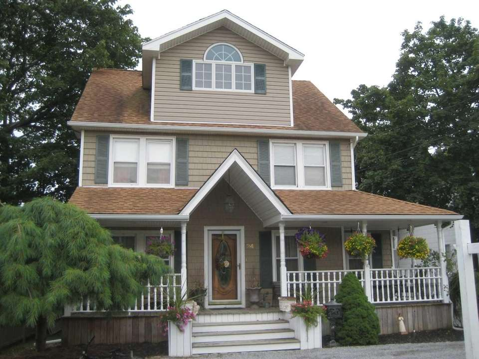 This updated circa-1905 Amityville Victorian comes with a