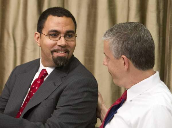 State Education Commissioner John King Jr., left, and