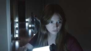 "Karen Gillian stars as Kaylie Russell in ""Oculus."""