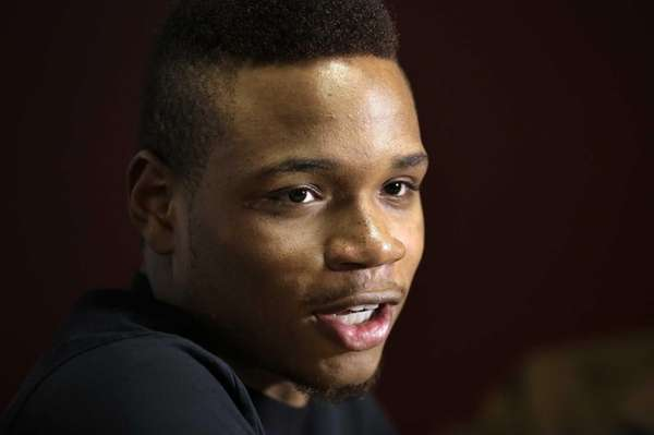 UMass guard Derrick Gordon talks with reporters on