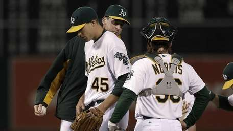 Oakland Athletics pitcher Jim Johnson (45) is relieved