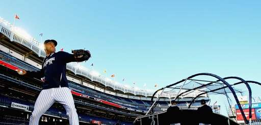Derek Jeter throws during batting practice before a