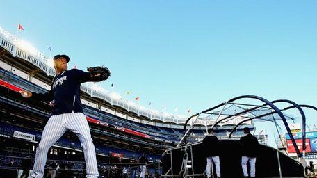 Derek Jeter throws during batting practice before a