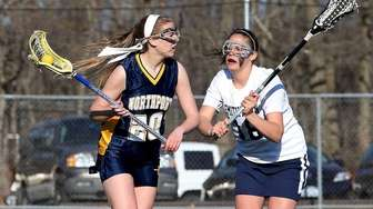 Northport's Julia Sarcona moves behind the net as