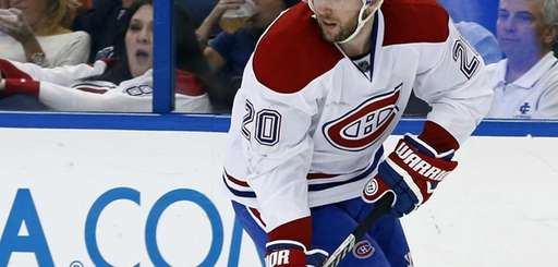 Thomas Vanek #20 of the Montreal Canadiens brings