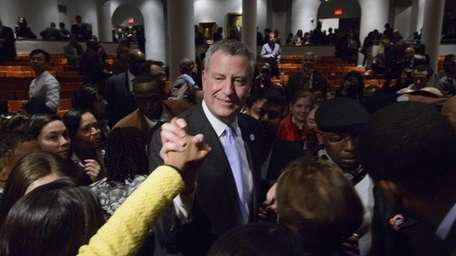New York City Mayor Bill de Blasio greets