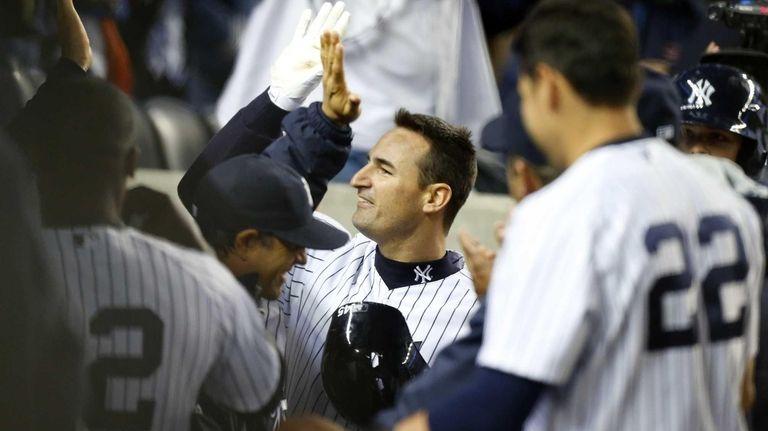 Dean Anna celebrates his fifth-inning home run during