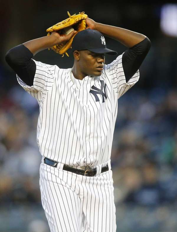 Michael Pineda delivers a pitch in the first