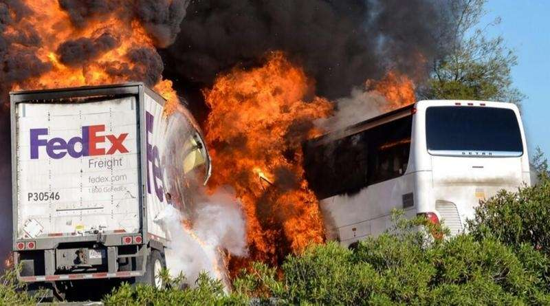Massive flames devour a bus and FedEx truck