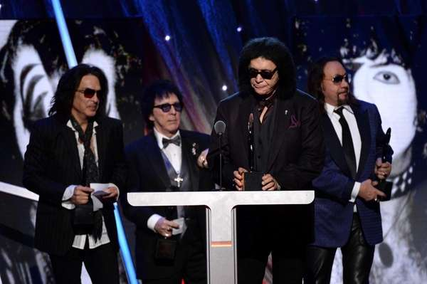 Members of Kiss accept their induction into the