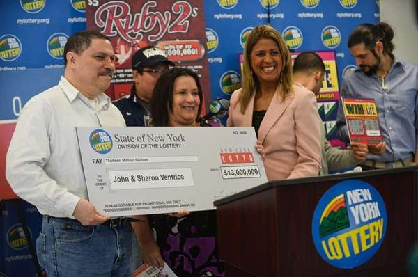 The New York Lottery's Yolanda Vega with winners