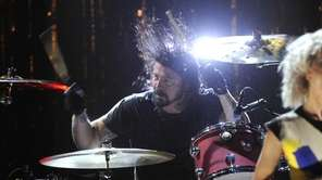 Dave Grohl performs with Nirvana following the band's