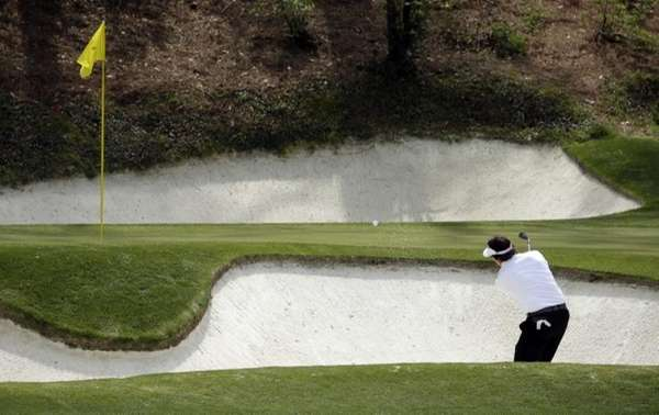 Phil Mickelson hits out of a bunker for