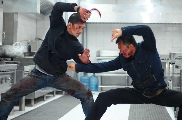 Iko Uwais, left, and Cecep Arif Rahman in