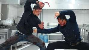 Iko Uwais, left, and Cecep Arif Rahman in