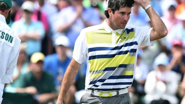 Bubba Watson reacts after putting on the 18th