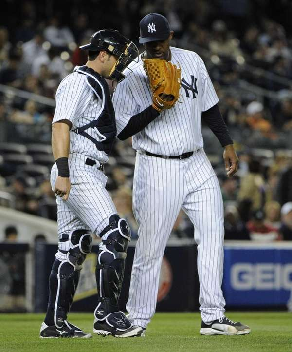 CC Sabathia and Francisco Cervelli meet against the