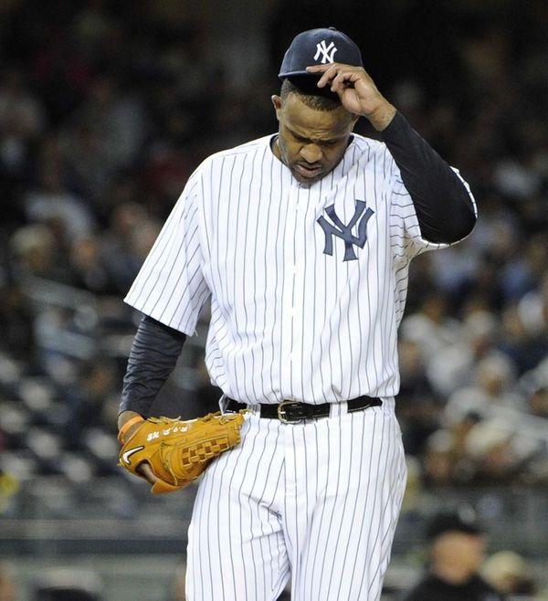 New York Yankees starting pitcher CC Sabathia reacts