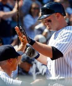Brian McCann of the Yankees celebrates his sixth