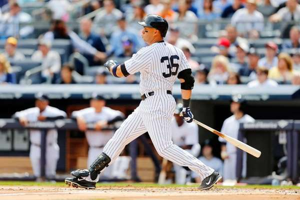 Carlos Beltran of the Yankees follows through on