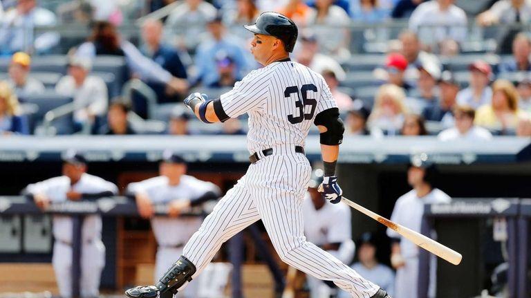 Carlos Beltran of the Yankees follows through on