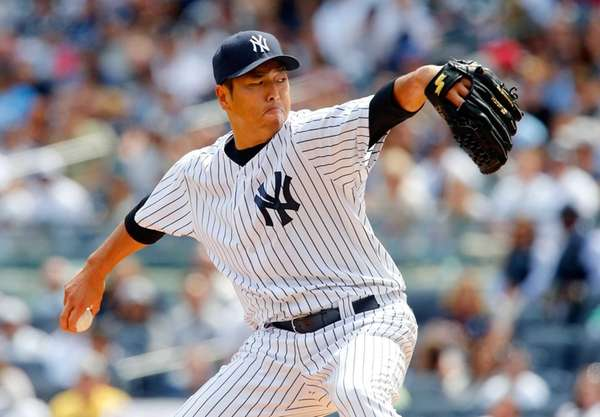 Hiroki Kuroda of the Yankees delivers a first