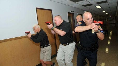 From left, Nassau Police officers Linda Brymer, Danny