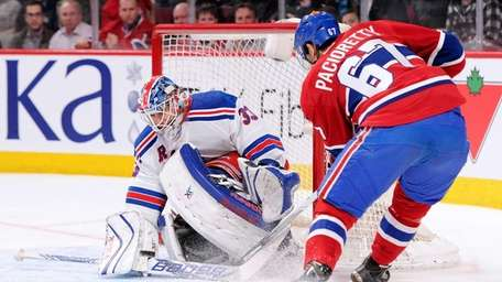 Cam Talbot of the Rangers stops the puck