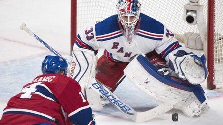 Rangers goaltender Cam Talbot makes a save against