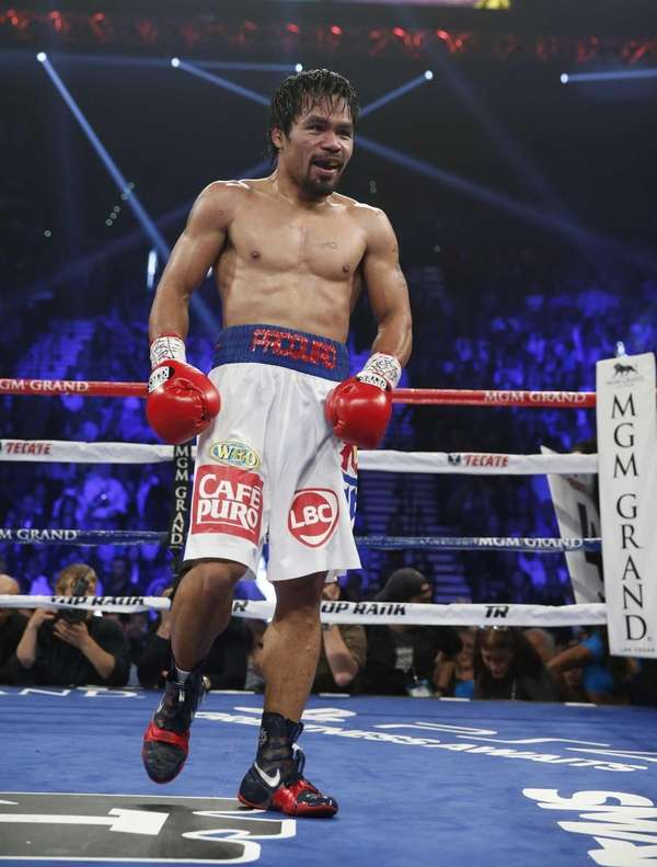 Manny Pacquiao, of the Philippines, returns to his