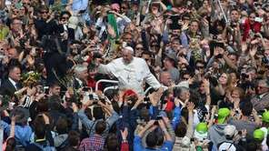 Pope Francis greets the crowd at the end
