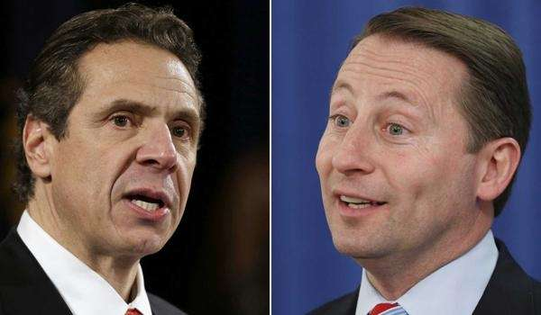 New York Gov. Andrew M. Cuomo, left, on
