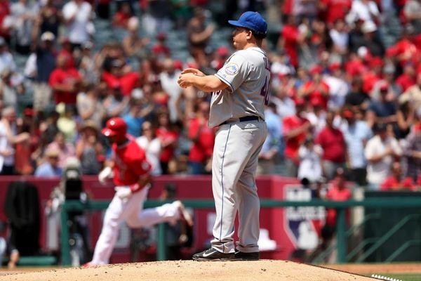 Bartolo Colon rubs up a new baseball as