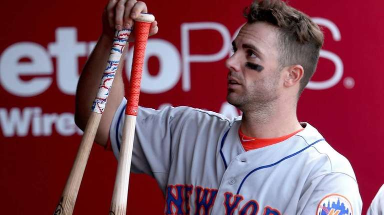 David Wright gathers his bats before returning to