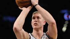Nets' forward/center Mason Plumlee shoots a free throw
