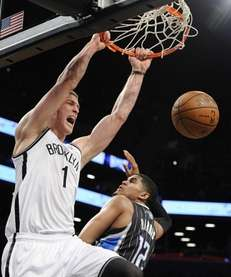 Mason Plumlee dunks against Orlando Magic forward Tobias