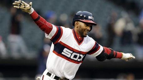 Chicago White Sox's Alexei Ramirez celebrates as he