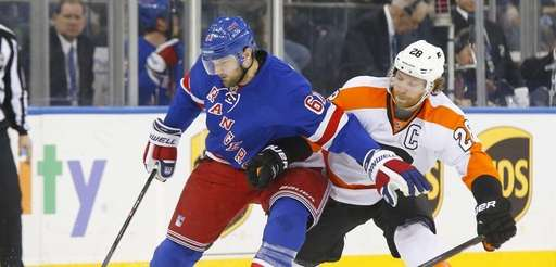 Rick Nash controls the puck in the third
