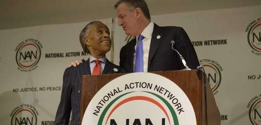 Mayor Bill de Blasio places his arm on