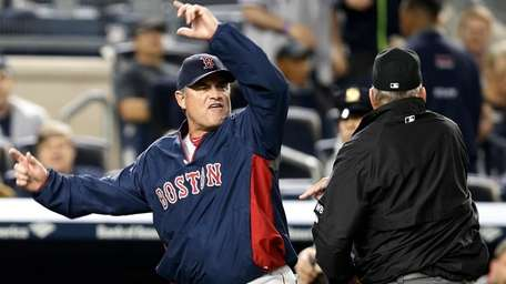 Boston Red Sox manager John Farrell gestures after