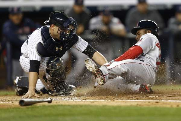 Catcher Brian McCann tags out Jackie Bradley Jr.