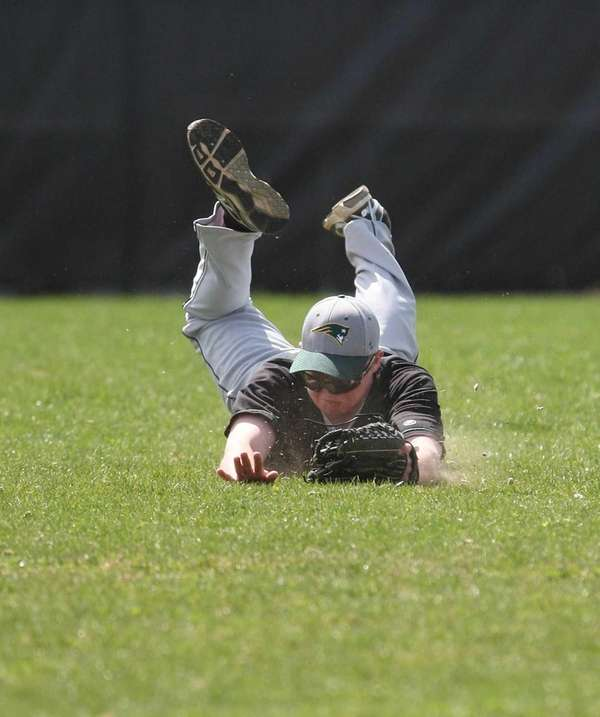 Ward Melville's Liam Stramm Walsh (18) makes a